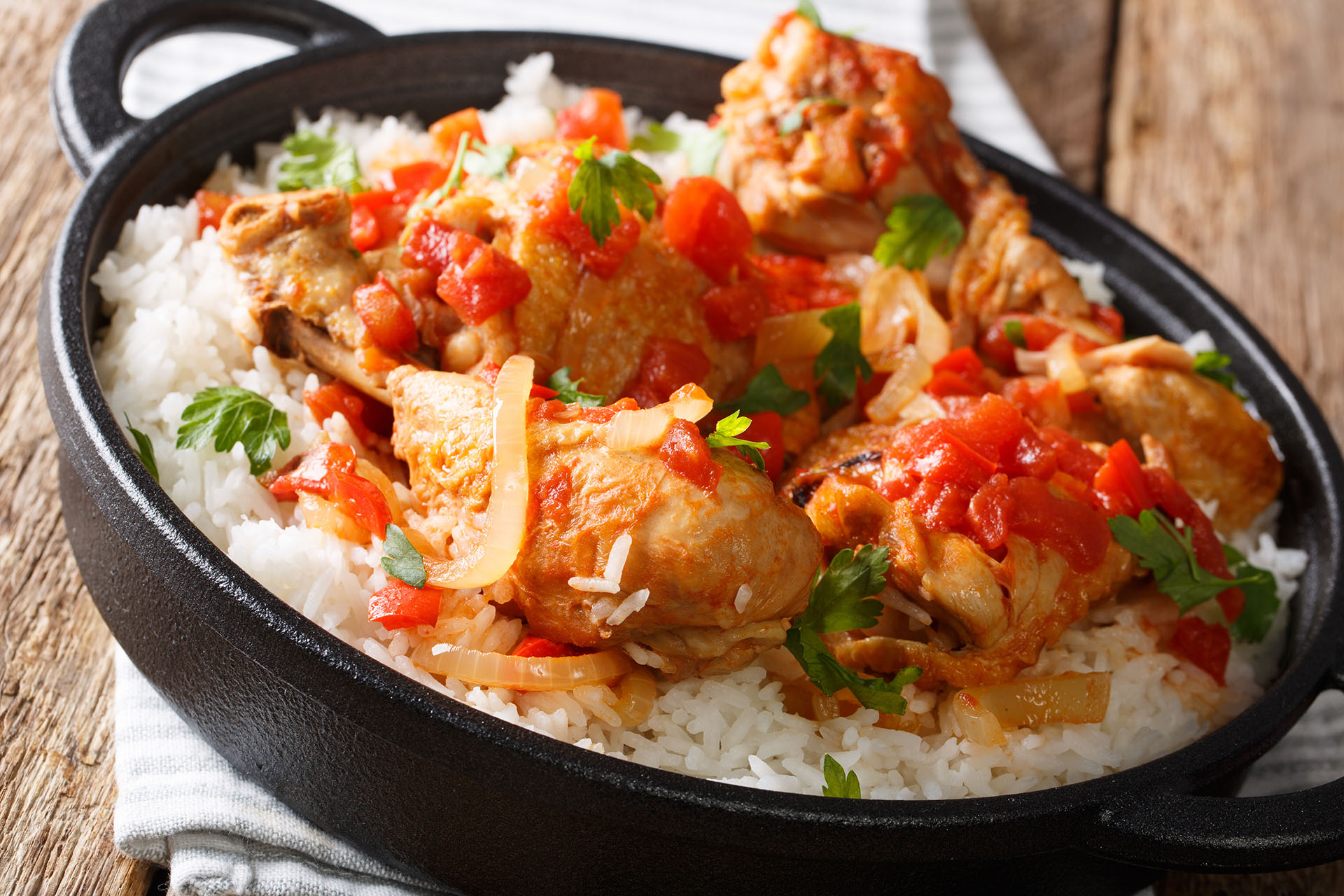 Haitian stewed Chicken (poulet creole) with rice closeup. horion